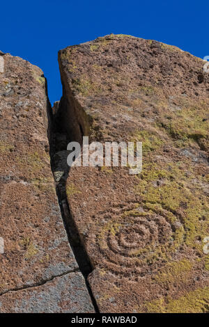 Petroglyph of concentric circlescarved into sandstone by Ancestral Puebloan People at the Tsankawi Prehistoric Sites in Bandelier National Monument ne - Stock Photo