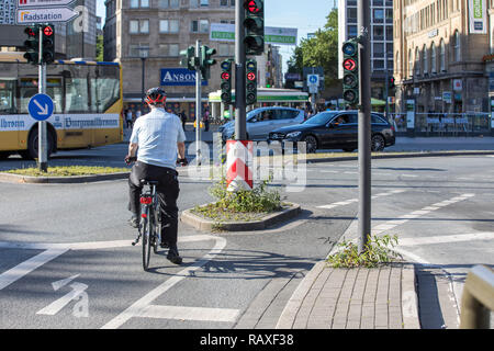 Inner-city bike path, especially marked cycle paths, bicycle lanes, for cyclists, in Essen, at a traffic light junction - Stock Photo