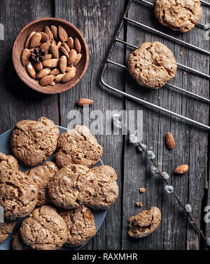 Homemade almond cookies on grey wooden table at rustic kitchen - Stock Photo