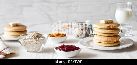 Bunch of homemade pancakes served with milk for breakfast - Stock Photo