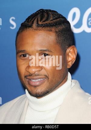 Los Angeles, CA, USA. 5th Jan, 2019. Usher at arrivals for The Art Of Elysium 12th Annual HEAVEN Gala, Private Venue, Los Angeles, CA January 5, 2019. Credit: Elizabeth Goodenough/Everett Collection/Alamy Live News - Stock Photo