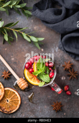 Tea with cranberry, orange, spices and mint in glass cup. Top view. Comfort winter or autumn drink - Stock Photo