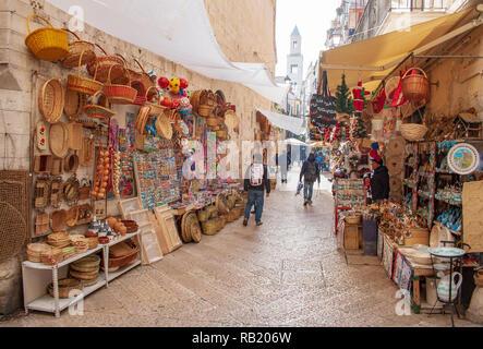 View of a narrow street in  Bari, Puglia, Italy, Bari vecchia, traditional open market shops with souvenir for tourists - Stock Photo