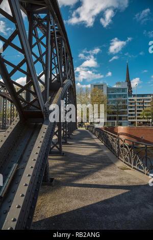 Bridge arch of a steel girder bridge in the Hamburger Speicherstadt - Stock Photo