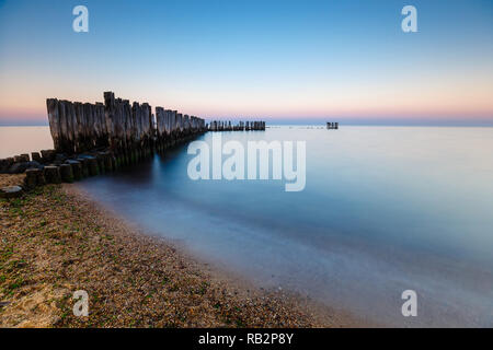 Blue hour at the sea. Beautiful and tranquil sunset over the sea - Stock Photo