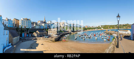 Panorama: panoramic view of Harbour Beach and historic waterfront buildings, Tenby, a walled seaside town, Carmarthen Bay, Pembrokeshire, south Wales - Stock Photo
