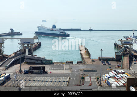 Ferry entering Port of Dover terminal. Lorries and cars waiting for channel crossing, Dover, Kent, UK, on a foggy summer day . - Stock Photo