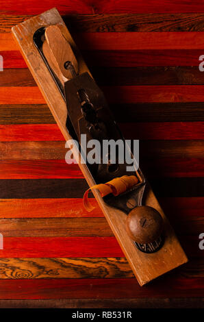 Woodworker's hand plane with wood shavings - Stock Photo