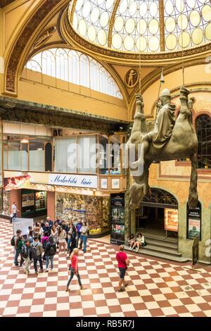 Statue of King Wenceslas Riding an Upside-Down Dead Horse by artist David Cerny Lucerna passage Prague Czech republic Europe - Stock Photo