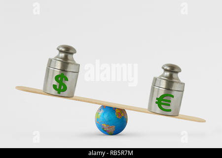 Dollar and euro symbols on balance scale - Concept of euro dominance over dollar in global markets - Stock Photo