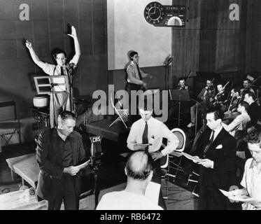 Orson Welles rehearsing a radio broadcast of H.G. Wells' classic, The War of the Worlds on October 10, 1938. The broadcast, which claimed that aliens from Mars had invaded New Jersey, terrified thousands of Americans. - Stock Photo