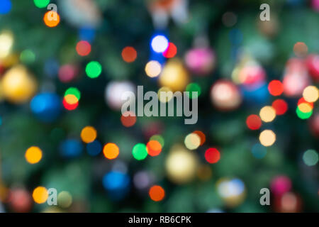 Out of focus fairy lights on a Christmas tree in England - Stock Photo