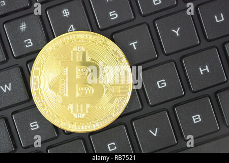 Golden bitcoin on keyboard. Crypto currency smart contract technology concept photo. - Stock Photo