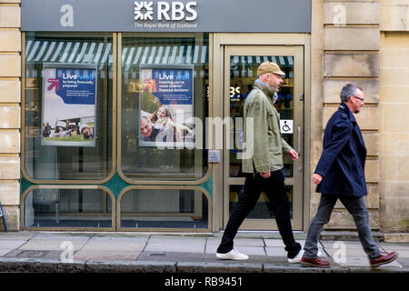 Shoppers are pictured walking past a high street branch of the Royal Bank of Scotland RBS bank in Bath, England, UK - Stock Photo