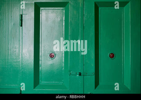 Green doors of an old freight Elevator in an industrial building.Old factory, texture - Stock Photo