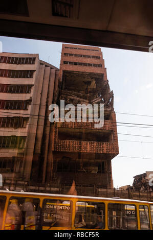 Belgrade, Serbia - June 09, 2013: View from autobus window on destroyed part of downtown building in Belgrade after airstrikes in civil war - Stock Photo