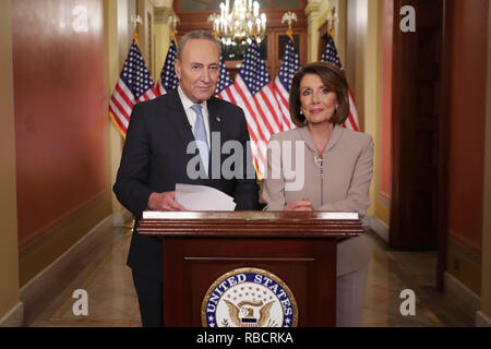 Washington, DC. 08th Jan, 2019. WASHINGTON, DC - JANUARY 08: Speaker of the House Nancy Pelosi (D-CA) (R) and Senate Minority Leader Charles Schumer (D-NY) pose for photographs after delivering a televised response to President Donald Trump's national address about border security at the U.S. Capitol January 08, 2019 in Washington, DC. Republicans and Democrats seem no closer to an agreement on security along the southern border and ending the partial federal government shutdown, the second-longest in history. Credit: Chip Somodevilla/Pool via CNP | usage worldwide Credit: dpa/Alamy Live News - Stock Photo