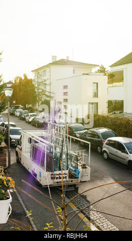 PARIS, FRANCE - NOV 22, 2017: View from above of white van transporting new windows to be installed in the house - Stock Photo