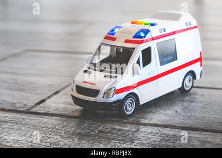 ambulance background toy medical health care vehicle sirens blue lights - Stock Photo