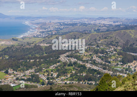 Aerial view of Pacifica and San Pedro Valley as seen from Montara mountain, San Francisco and Marin County in the background, California - Stock Photo