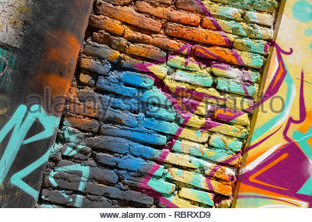 Spray painted brickwork, an example of the street art visible in Valparaiso, Chile. - Stock Photo
