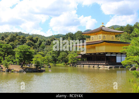 The golden temple, Kinkaku-ji, officially named Rokuon-ji, is a Zen Buddhist temple in Kyoto, Japan. - Stock Photo