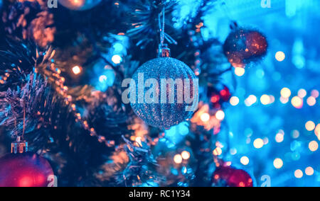 A Christmas tree is a decorated tree, usually an evergreen conifer such as spruce, pine, or fir or an artificial tree of similar appearance - Stock Photo