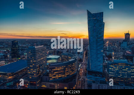 Warsaw cityscape. Panoramic view on the city buildings at sunset in the capital of Poland. - Stock Photo