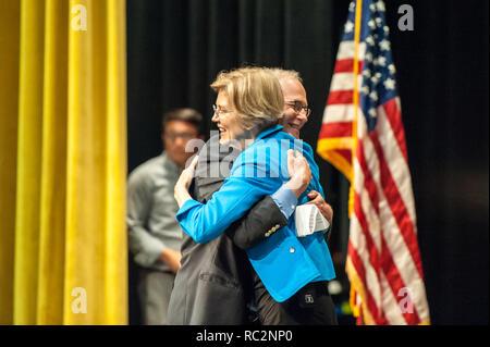 U.S. Senator Elizabeth Warren hugging Massachusetts Senator Mike Barrett - Stock Photo