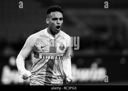 Black and White image of Forward Lautaro Martínez (Inter) celebrating after scoring a goal during the Italian Cup 'Coppa Italia' football match, Inter Milan vs Benevento Calcio at San Siro Meazza Stadium in Milan, Italy on 13 January 2019. The football match is played behind closed doors after Napoli's Senegalese player Kalidou Koulibaly was subject to racist chants by FC Internazionale's 'ultra' fans during the Boxing Day match. Credit: Piero Cruciatti/Alamy Live News - Stock Photo