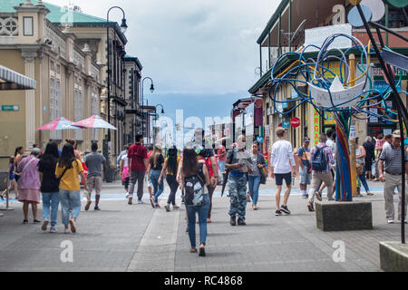 A photo of pedestrians walking on a busy street in the old town of San Jose, Costa Rica - Stock Photo
