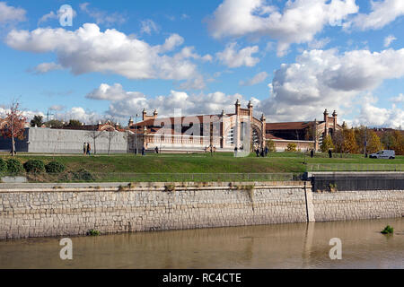 Madrid - Madrid Rio park area for sports and leisure on Manzanares River. In the background Matadero Madrid cultural center - Stock Photo