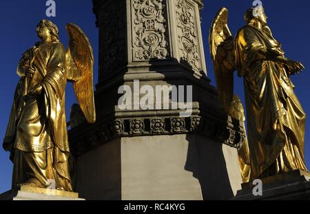 Croatia. Zagreb. Holy Mary's column with angels and fountain by the German-Austrian sculptor Anton Dominik Fernkorn (1813-1878) in 1865. The fountain was built by the Austrian architect Hermann Bolle (1845-1926) between 1880-1882. Two of the four golden angels located on the pedestal. Kaptol Square. - Stock Photo