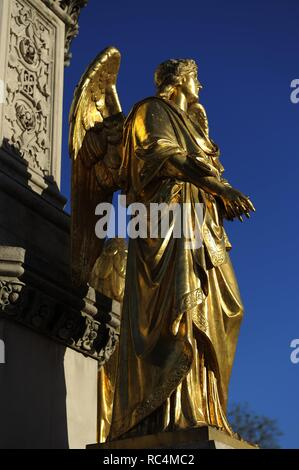 Croatia. Zagreb. Holy Mary's column with angels and fountain by the German-Austrian sculptor Anton Dominik Fernkorn (1813-1878) in 1865. The fountain was built by the Austrian architect Hermann Bolle (1845-1926) between 1880-1882. One of the four golden angels located on the pedestal. Kaptol Square. - Stock Photo