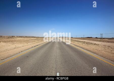 Lonely road through the Empty Quarter, ar-Rub al-Khali, Oman, Arabian Peninsula, Middle East, Asia - Stock Photo