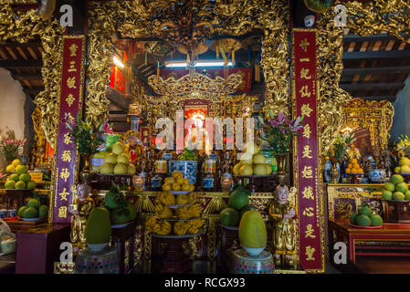 Altar in a Buddhist temple in front of One Pillar Pagoda, Hanoi, Vietnam - Stock Photo