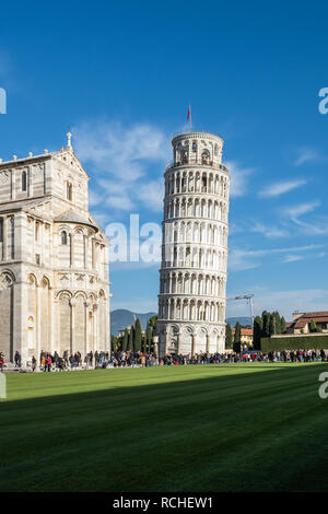 January 01, 2019 Pisa, Tuscany, Italy - Leaning Tower of Pisa and a side of the Pisa Cathedral viewed from the south east side - Stock Photo