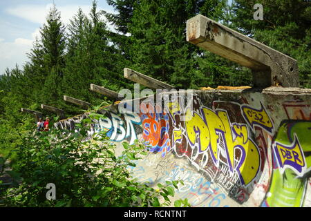 Abandoned Olympic Bobsleigh and Luge Track with lots of graffiti in Sarajevo, Bosnia - Stock Photo