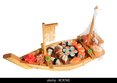 Set of sushi rolls on a wooden ship. Isolated on white background. Creative dish on the menu. - Stock Photo