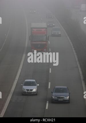 Autobahn A52, motorway, in thick fog, autumn, visibility under 100 metres, between Duesseldorf and Essen, North Rhine-Westphalia - Stock Photo