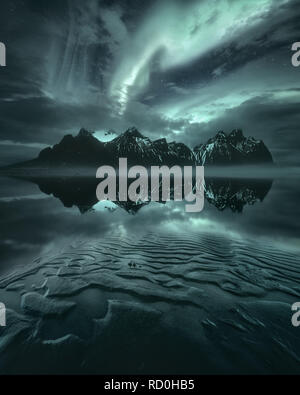 Northern lights over Vestrahorn mountain, Stokksnes Peninsula, Iceland - Stock Photo