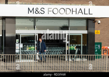 The front entrance of a Marks And Spencer Food Hall shop in Worthing, Sussex, England. - Stock Photo