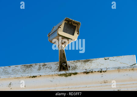 A CCTV security​ camera on a building. - Stock Photo