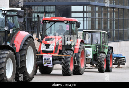 Erfurt, Germany. 17th Jan, 2019. Thuringian farmers protest with their tractors in front of the Thuringian parliament against the sale of land to investors. They are also taking part in a demonstration on 19 January in Berlin. Credit: Martin Schutt/dpa-Zentralbild/dpa/Alamy Live News - Stock Photo