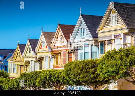 Famous Painted Ladies, a row of colorful Victorian houses located near scenic Alamo Square, on a beautiful sunny day, San Francisco, USA - Stock Photo