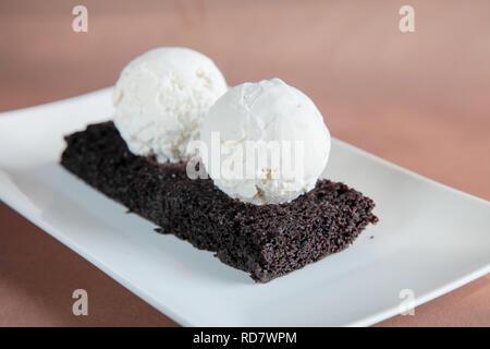 Chocolate Brownie with Vanilla Ice Cream - Stock Photo
