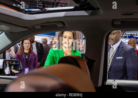 Detroit, Michigan - Michigan Governor Gretchen Whitmer tours the North American International Auto Show with General Motors Vice President Gerald John - Stock Photo