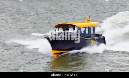 Water Taxi speeding on river Maas. For tourists who want spectacular sightseeing by water at 50kph water taxi is a must! - Stock Photo