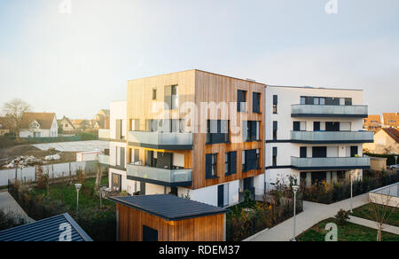 Aerial view of modern townhouses in a residential area with multiple new apartments buildings surrounded by green outdoor facilities tilt-shift lens used - Stock Photo
