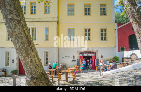 tourists and spa guests in front of o tasco, wine & beer bar, serra de monchique - Stock Photo